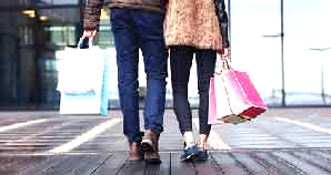 Couple walking with shopping bags.